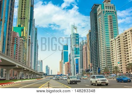 Dubai, United Arab Emirates - May 1, 2013: traffic on Sheikh Zayed Road, highway E 11, which runs through Dubai and is home to the most modern skyscrapers located in the Dubai Downtown district.