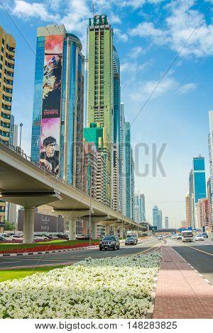 Dubai, United Arab Emirates - May 1, 2013: metro railway bridge and modern skyscrapers around Dubai Downtown district in UAE. Underground lines without a driver in the Dubai metro.