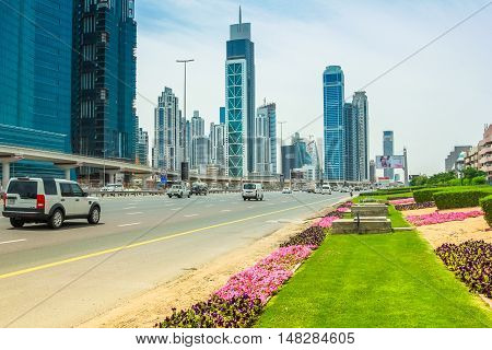 Dubai, United Arab Emirates - May 1, 2013: Sheikh Zayed Road, highway E 11, which runs through Dubai and is home to the most modern skyscrapers located in the Dubai Downtown district.