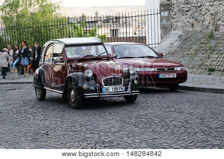 PARIS, FRANCE - MAY 12, 2015: It is an old Citroen Citroen 2 CB the legend of the French car industry on the cobbled steets of Montmatre.