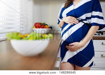 Pregnant Woman And Bowl Of Salad