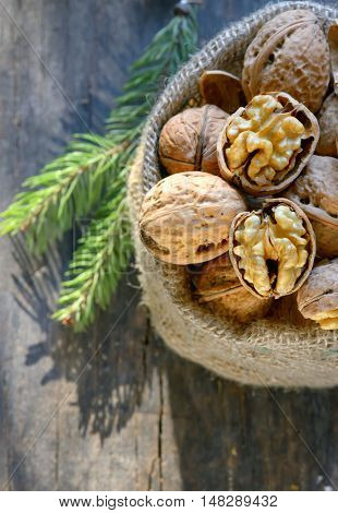 walnuts in a bag on a wooden background
