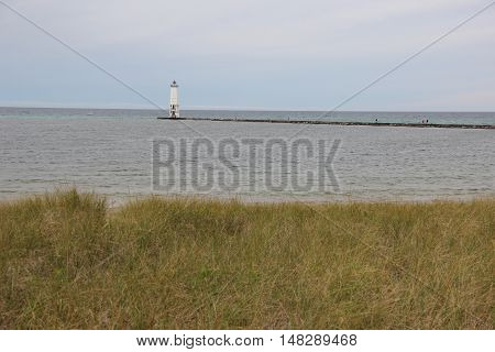Dune grass with the Frankfort, Michigan Lighthouse in the background