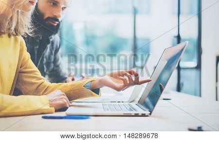 Closeup Two Modern Coworkers Discussing Together During Working Process.Young Business People Meeting Concept.Discussion Startup Project Office.Bearded Hipster Work Laptop Wood Desk Table.Blurred