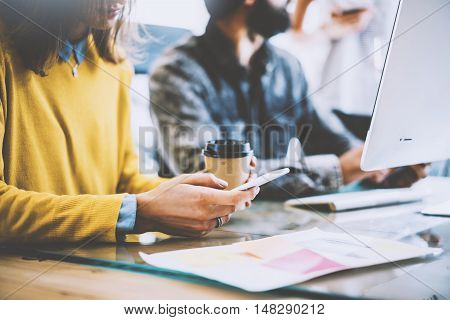 Business Startup Concept.Coworkers Meeting During Work Process.Bearded Hipster Making Great Decisions.Young Woman Using Smartphone Hand.People Working New Project Wood Desk Table.Blurred
