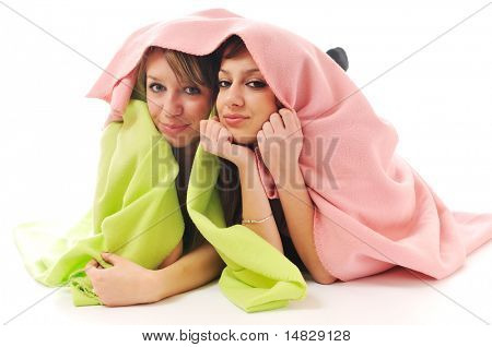 two youg happy giril woman smiling unger blanket isolated representing concept of lesbian love, happynes and softnes