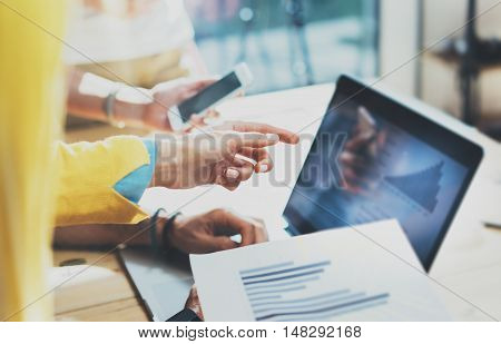 Closeup Young Woman Using Modern Tablet Hand.Hipster Working Great Business Idea Process.Coworkers People Gathered Together Decision Corporate Work.Startup Creative Presentation Concept Blurred