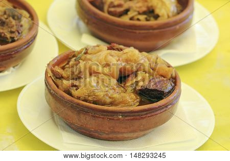 Cooked cabbage with meat in clay pot