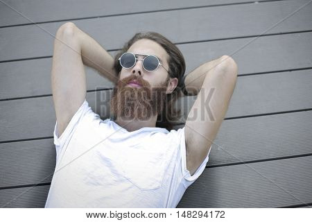 Man lying with sunglasses on