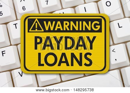 Online Payday Loans Warning Sign A yellow warning sign with text Payday Loans on a keyboard, 3D Illustration