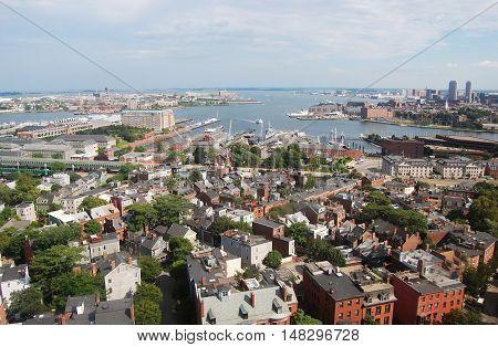 Boston Inner Harbor. Boston waterfront skyline and Logan International Airport, viewed from Bunker Hill Monument, Charlestown, Massachusetts, USA.