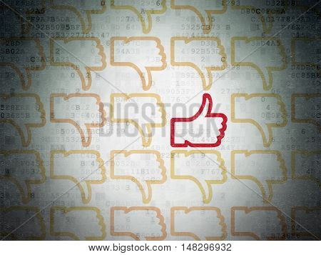 Social media concept: rows of Painted yellow thumb down icons around red thumb up icon on Digital Data Paper background