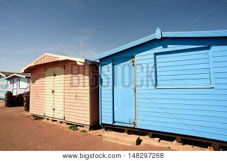 Pink And Blue Painted Summer Beach Huts