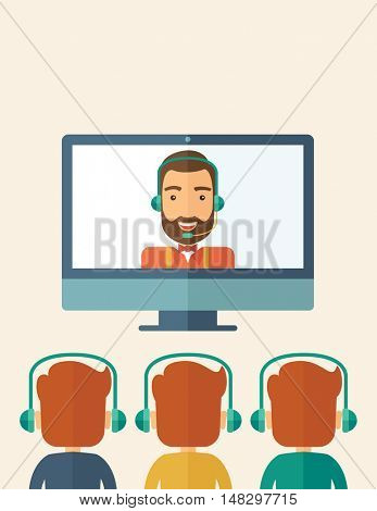 A happy Caucasian businessman in a monitor with beard giving a business presentation with three men infront of him wearing their headphones . Business presentation concept. A contemporary style with