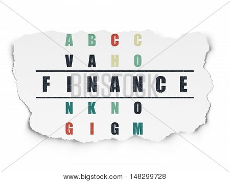 Banking concept: Painted black word Finance in solving Crossword Puzzle on Torn Paper background