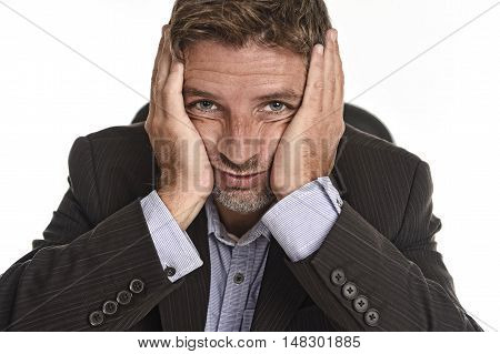 close up portrait of young attractive businessman in suit looking tired and exhausted suffering stress and headache isolated on white background in work problem and depression concept