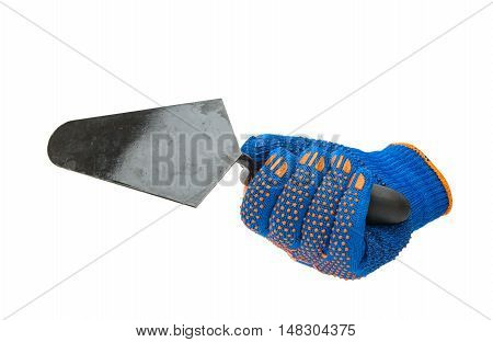 Building trowel in male hand with construction gloves isolated on white