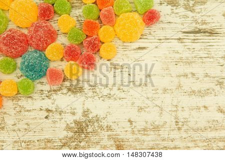 Colorful jelly beans on a wooden bakcground.