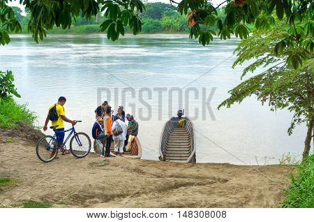 MOMPOX COLOMBIA - MAY 27: Passengers board boats in Mompox Colombia on the Magdalena River on May 27 2016