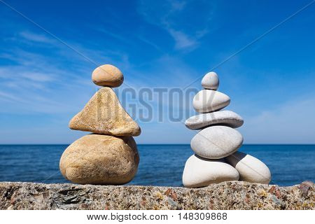 Two figures of white and yellow stones. stones balance. Rock zen