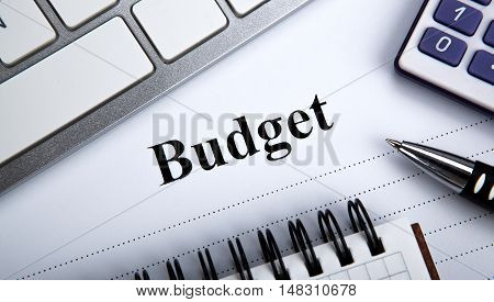 document with title budget and office tools close up