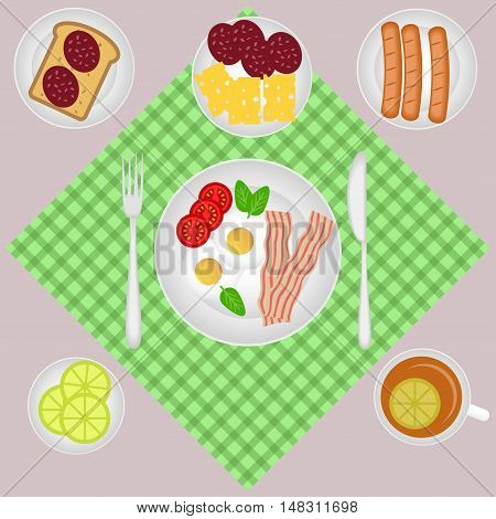 Breakfast set with tea, lemon, bacon and eggs