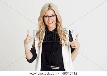 Happy and surprised young confident business lady, looking at the camera, white background