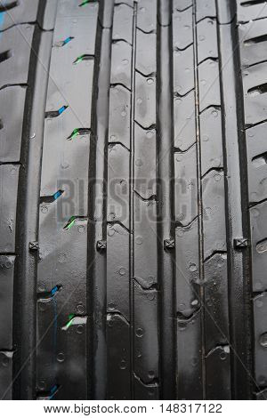 Car tires profile accessories, grip, black closeup
