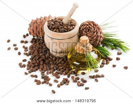 Cedar pine nuts in a mortar cones oil cedar brunch isolated on white background.