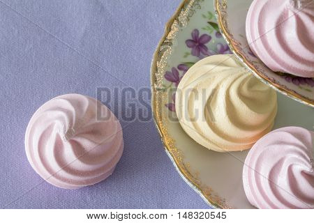 Pastel Meringues from Above on Vintage Tiered Plate