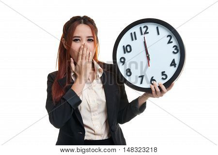 Sleepy Young Asian Business Woman With A Clock In The Morning.