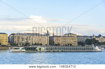 BUDAPEST, SEPTEMBER 17, 2016: Pleasure and cruise ships on the Danube River on September 17, 2016 in Budapest, Hungary. Tourist trips along the Danube River in Budapest on water transport are in great demand by travelers from around the world.