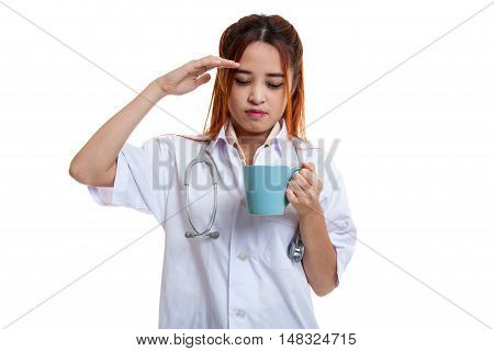 Asian Young Female Doctor Got Headache With A Cup Of Coffee.