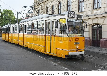 BUDAPEST, SEPTEMBER 17, 2016: Yellow tram in Budapest, Hungary on September 17, 2016 in Budapest, Hungary. Yellow tram in Budapest goes from all the historical attractions of the city.