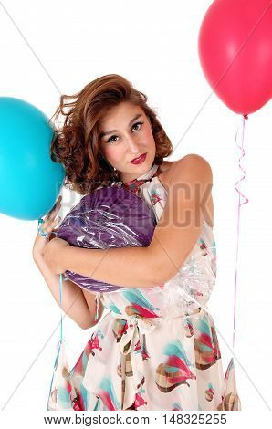 A gorgeous young woman with a big lollipop and balloons standing waist up isolated for white background