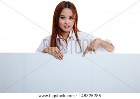 Young Asian Female Doctor Point Down To Blank Sign.