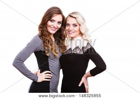 Generation and relationship. Portrait adult daughter with mother. Two attractive elegant women long curly hairs blonde mom and brown haired girl studio shot
