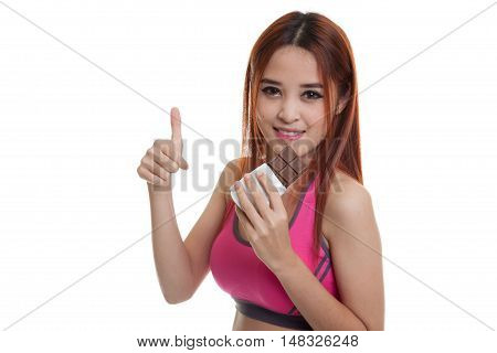 Beautiful Healthy Asian Girl Thumbs Up With Chocolate.