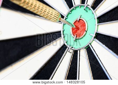 Single Dart Stuck In A Bullseye Board