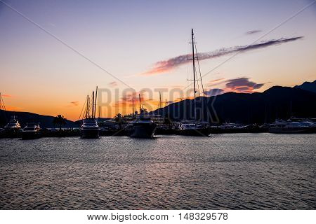 Sailing boats and yachts in marina. Porto Montenegro background on the sunset