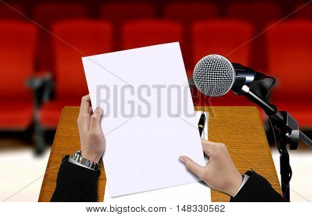 Seminar preparation with a man holding presentation sheet