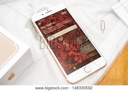 PARIS FRANCE - SEP 16 2016: New Apple iPhone 7 Plus unboxing in the first day of sales - Welcome to HomeKit connected home app. New Apple iPhone acclaims to become the most popular smart phone in the world in 2016