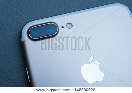 PARIS FRANCE - SEP 16 2016: New Apple iPhone 7 Plus unboxed in the first day of sales - two camera lenses rear view on colorful background. New Apple iPhone claims to become the most popular smart phone in the world in 2016