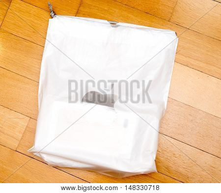 PARIS FRANCE - SEP 16 2016: New Apple iPhone 7 Plus unboxing in the first day of sales - iPhone box in plastic Apple Bag. New Apple iPhone acclaims to become the most popular smart phone in the world in 2016