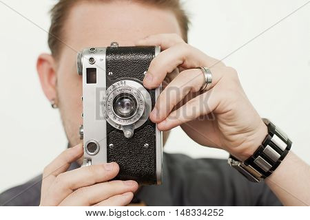 Young male using a vintage 35mm film camera