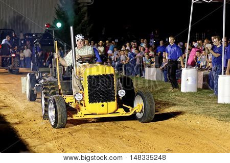 MYERSTOWN PENNSYLVANIA - SEPTEMBER 16 2016: A man drives a modified tractor at Myerstown East End Days. The tractor pull is an annual community event.