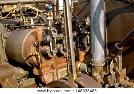 The external parts of pistons are displayed on the engine of a very old steam engine