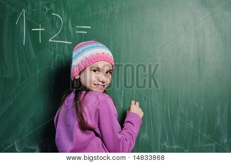 happy school girl on math classes finding solution and solving problems