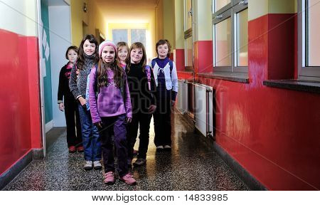 happy childrens group in schoold have fun and learning leassons