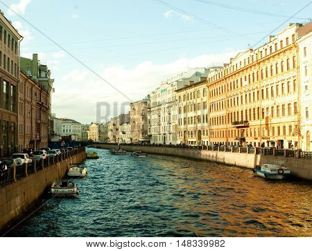 River channel with boats in Saint-Petersburg. Summer time.